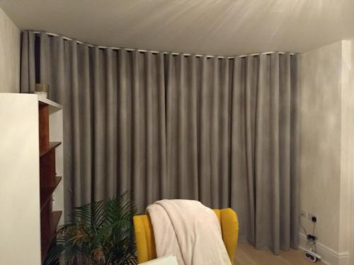 Wave Curtains on a ceiling mounted discrete track